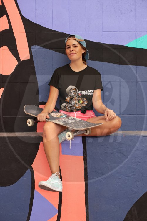 knotted-tee-mockup-of-a-skater-woman-sitting-in-front-of-an-urban-mural-27068.