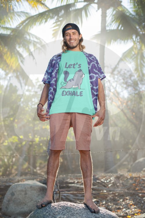 t-shirt-mockup-of-a-beach-attire-man-posing-in-the-light-of-day-26764.