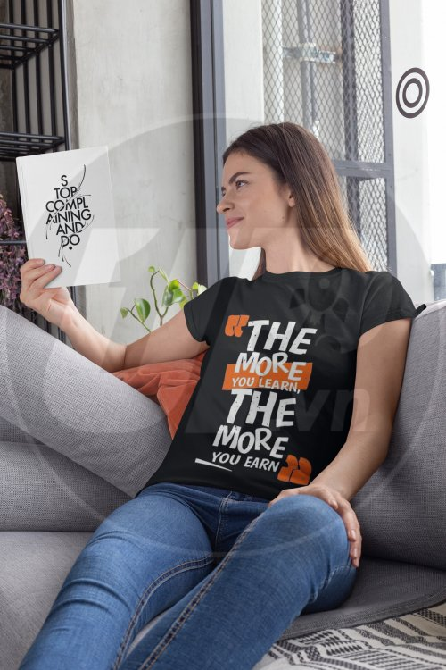 t-shirt-mockup-of-a-woman-sitting-on-a-couch-while-reading-a-book-28482.